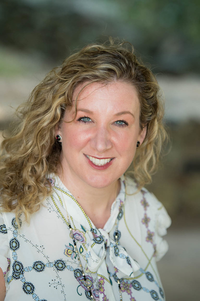 Headshot of Bellwether Education Partners team member Beth Tek