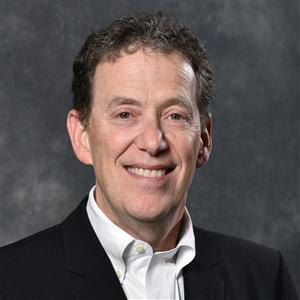 Headshot of Bellwether Education Partners board member Dr. Paul Goren